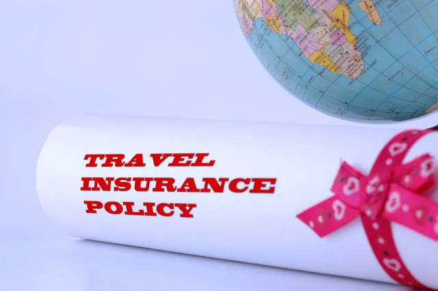 Travel insurance policy beside a globe