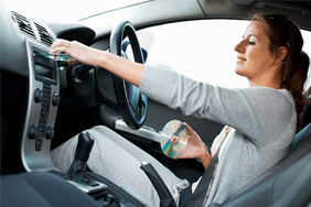 Woman adjusting car radio