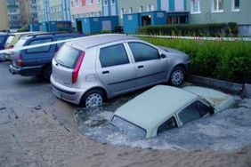 Car sinking in puddle