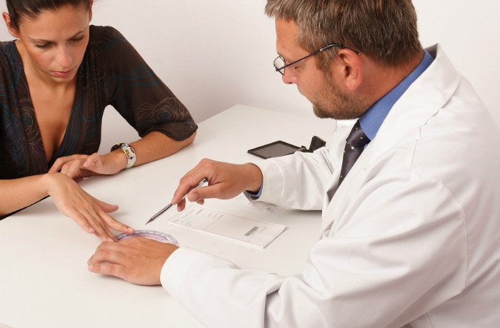 A Doctor consulting with a patient at a desk