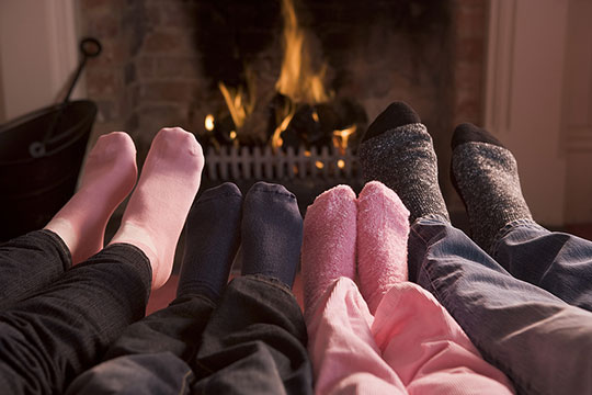 warming feet by fire
