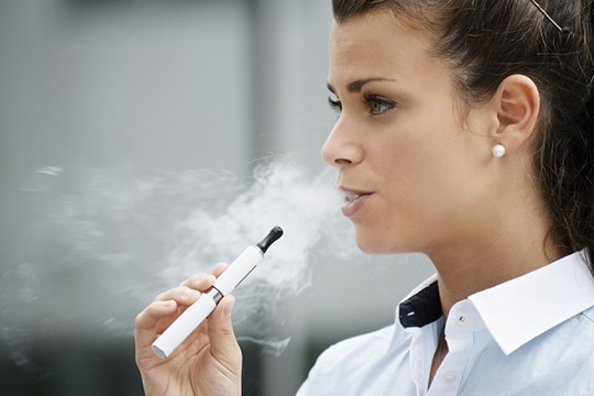 Woman using e-cigarette