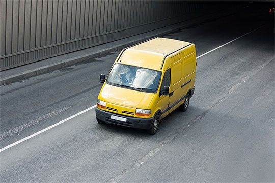 Yellow van driving